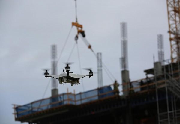 Survey drone hits crane on construction site